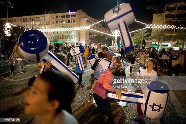Israeli children play as Israelis celebrate the Jewish state's 65th Independence Day on April 15 2013 in Tel Aviv Israel