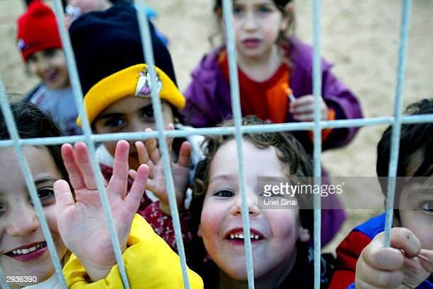 Israeli children play in the Israeli settlement of Alei Sinai February 5 2004 in the northern Gaza Strip Israel's Deputy Prime Minister Ehud Olmert...