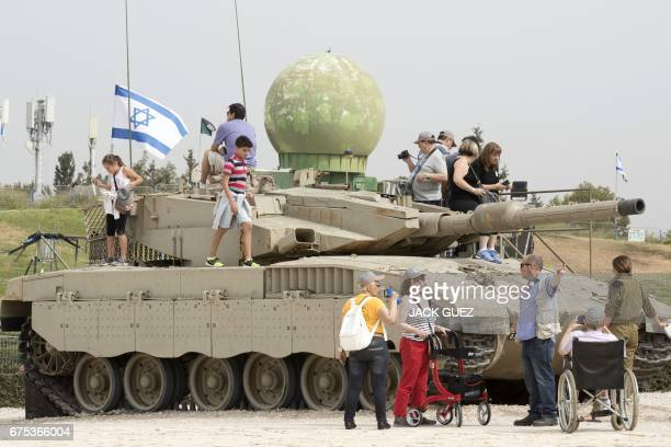 Israeli children play on top of a tank at the Armored Corps Memorial following a ceremony to mark Remembrance Day on May 1 2017 in Latrun between...
