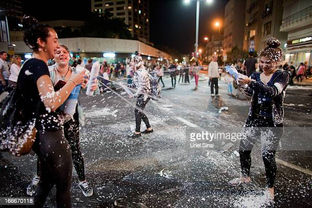 Israeli children play with foam spray as Israelis celebrate the Jewish state's 65th Independence Day on April 15 2013 in Tel Aviv Israel