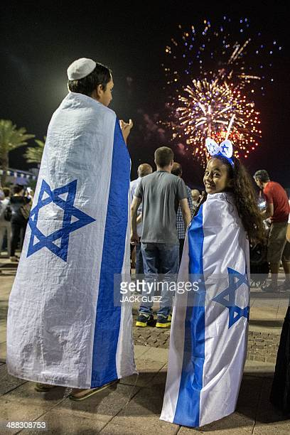 Israeli children watch fireworks in the Mediterranean coastal city of Netanya on May 5 during Israel's 66th Independence Day celebrations Israel's...