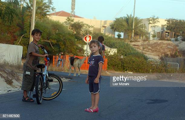 Israeli chldren play in the Jewish settlement of Rafa Yam southern Gaza Strip, Monday July 11, 2005. A delegation of senior Israeli officials that...