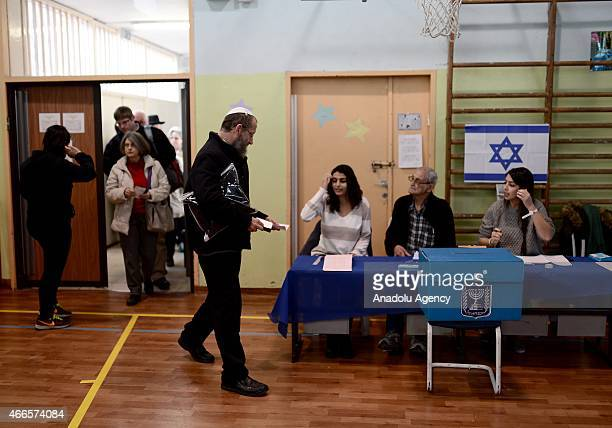 Israeli citizens are seen at a polling station during legislative election in Jerusalem Israel on March 17 2015 Voting begin in Israels elections...