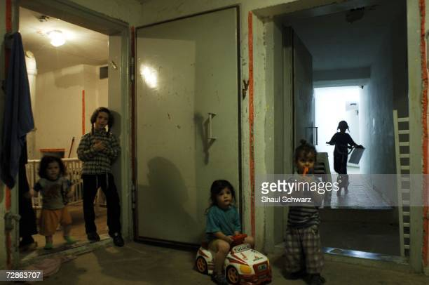 Israeli citizens sit in a shelter under their building during a Hezbollah missile attack July 19 2006 in Safed in northern Israel Hezbollah continued...