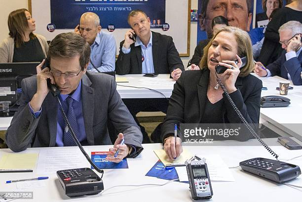 Israeli coleaders of the Zionist Union list for the upcoming general election Labour Party leader Isaac Herzog and MP Tzipi Livni talk on the phone...