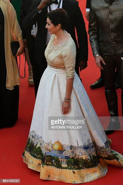Israeli Culture Minister Miri Regev wearing a dress featuring the old city of Jerusalem arrives on May 17 2017 for the screening of the film...