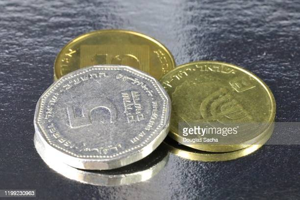 israeli currency, various valued shekel coins - global awards stock pictures, royalty-free photos & images