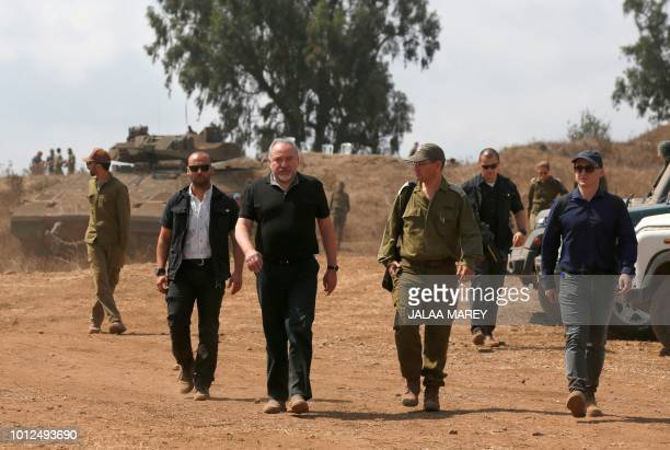 Israeli Defence Minister Avigdor Lieberman walks with army officers during a visit to the IsraelSyria border in the annexedGolan Heights on August 7...