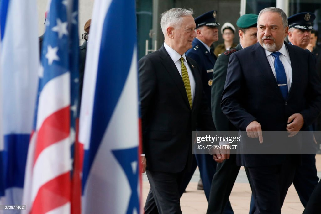 Israeli Defence Minister Avigdor Lieberman (R) welcomes US Defence Secretary James Mattis at the Ministry of Defence in Tel Aviv on April 21, 2017. /