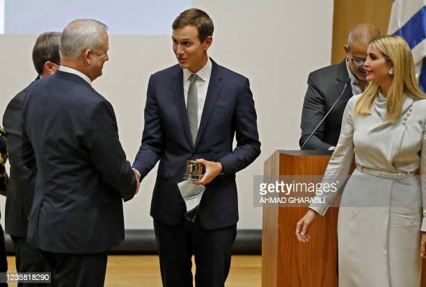 Israeli Defence Minister Benny Gantz shakes hands with US businessman and former Trump-administration presidential advisor Jared Kushner alongside...
