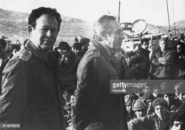 Israeli Defence Minister Shimon Peres and General Mordechai Gur , the Chief of Staff of the Israeli Defense Forces , talking to soldiers of the...