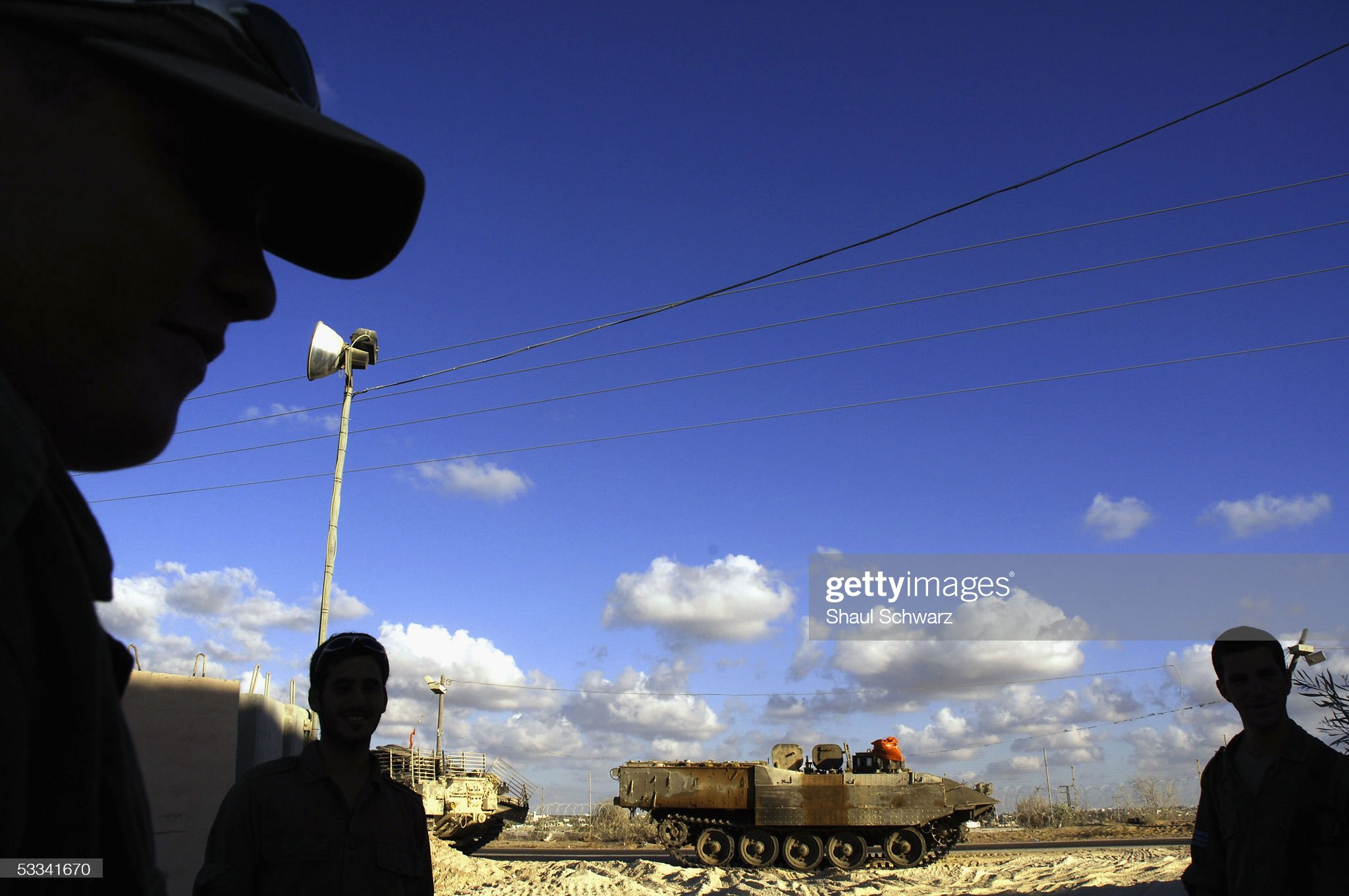 https://media.gettyimages.com/photos/israeli-defense-force-soldiers-stand-near-tanks-august-8-2005-at-picture-id53341670?s=2048x2048