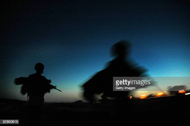 Israeli Defense Forces soliders walk through sand dunes during a night ambush May 18 2005 outside the settlement of Morag in the Gaza strip Tension...