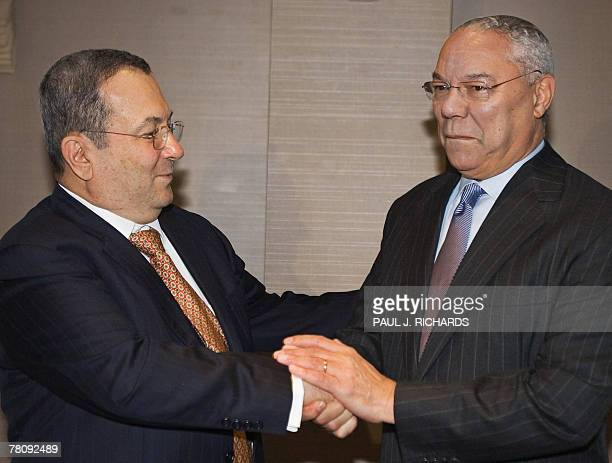 Israeli Defense Minister Ehud Barak and former US Secretary of State Colin Powell greet each other 26 November 2007 as they meet for a private lunch...
