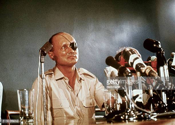 Israeli Defense Minister Moshe Dayan hero of the 1956 Sinai campaign addresses a press conference In this his first meeting with the press since he...