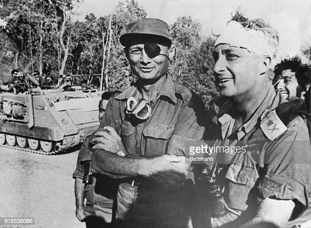 Israeli Defense Minister Moshe Dayan stands with Major General Ariel Sharon on west bank of Suez Canal, October 18th, the second day of Israel's push...
