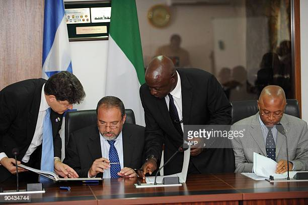 Israeli Deputy Prime Minister and Foreign Affairs Minister Avigdor Lieberman signs a Trade and Economic Cooperation Agreement flanked by Nigerian...