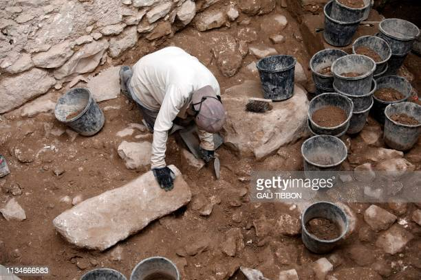 Israeli diggers of the Israel Antiquities Authority work at the spot where a 2600yearold bulla bearing a Hebrew name that was discovered inside a...