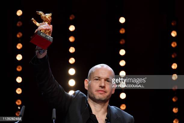 TOPSHOT Israeli director Nadav Lapid celebrates with his Golden bear for best film for Synonymes during the awards ceremony of the 69th Berlinale...