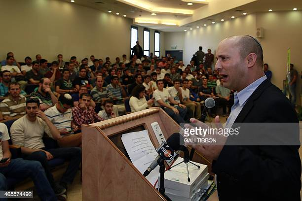 Israeli Economy Minister and head of the farright Jewish Home party Naftali Bennett speaks during an electoral rally in Jerusalem on March 8 2015 as...