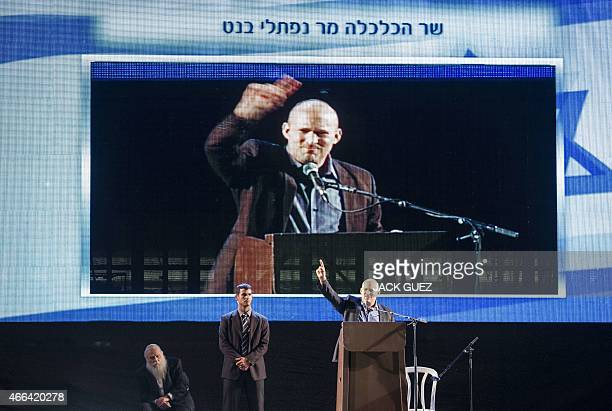 Israeli Economy Minister and head of the rightwing Jewish Home party Naftali Bennett who runs for the country's general election speaks during a...