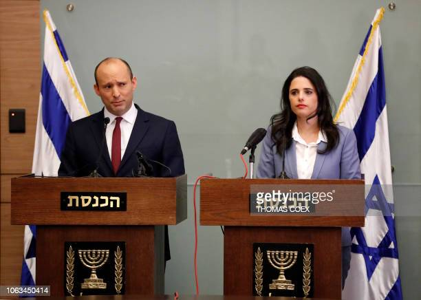 Israeli Education Minister Naftali Bennett and Justice Minister Ayelet Shaked give a statement at the Knesset in Jerusalem on November 19 2018 The...