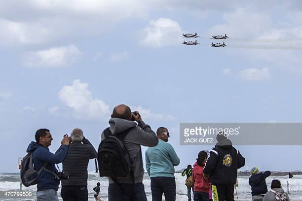 Israeli Efroni T6 Texan II planes perform during an air show over the beach in the coastal city of Tel Aviv on April 23 2015 as Israel marks...