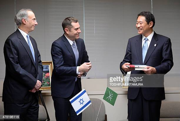 Israeli embassy's Deputy Chief of Mission Peleg Lewi and Jewish community of Japan president Philip Rosenfeld smile with Ryo Tanaka Mayor of Suginami...