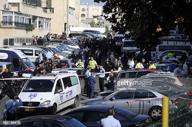 Israeli emergency personnel and police at the crime scene in front Jerusalem synagogue The two suspected Palestinians who carried out the attack were...