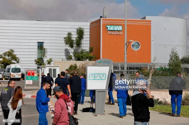 Israeli employees of Teva the world's biggest manufacturer of generic drugs gather outside the pharmaceutical company's plant in Ne'ot Hovav an...