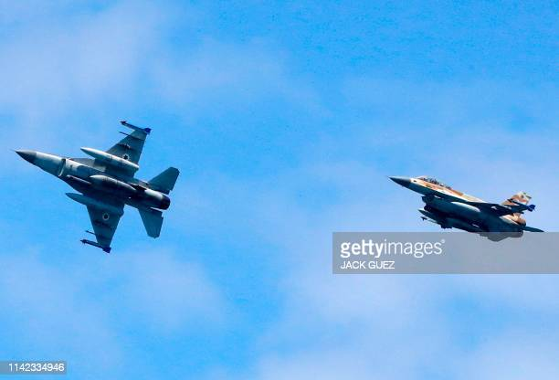 Israeli F16 fighter jets perform during an air show over the beach in the Mediterranean coastal city of Tel Aviv on May 9 2019 as Israel marks...