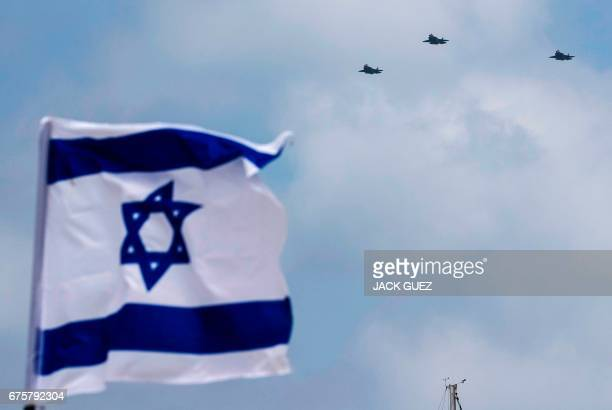 Israeli F35 fighter jets perform during an air show over the beach in the Israeli coastal city of Tel Aviv on May 02 2017 as Israel marks...