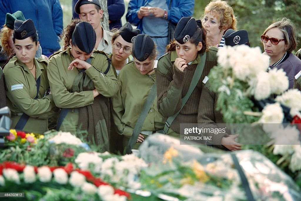 Israeli female soldiers grieve at the grave of assassinated Israeli Prime Minister Yitzhak Rabin at the Jerusalem Mount Herzl military cemetery on November 8, 1995.