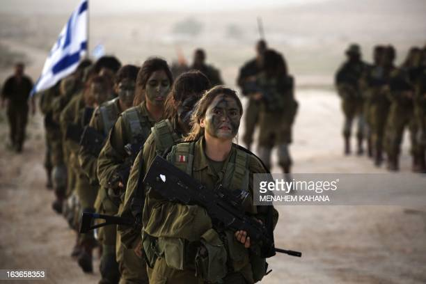 Israeli female soldiers of the 33rd Caracal Battalion take part in a graduation march in the northern part of the southern Israeli Negev desert on...