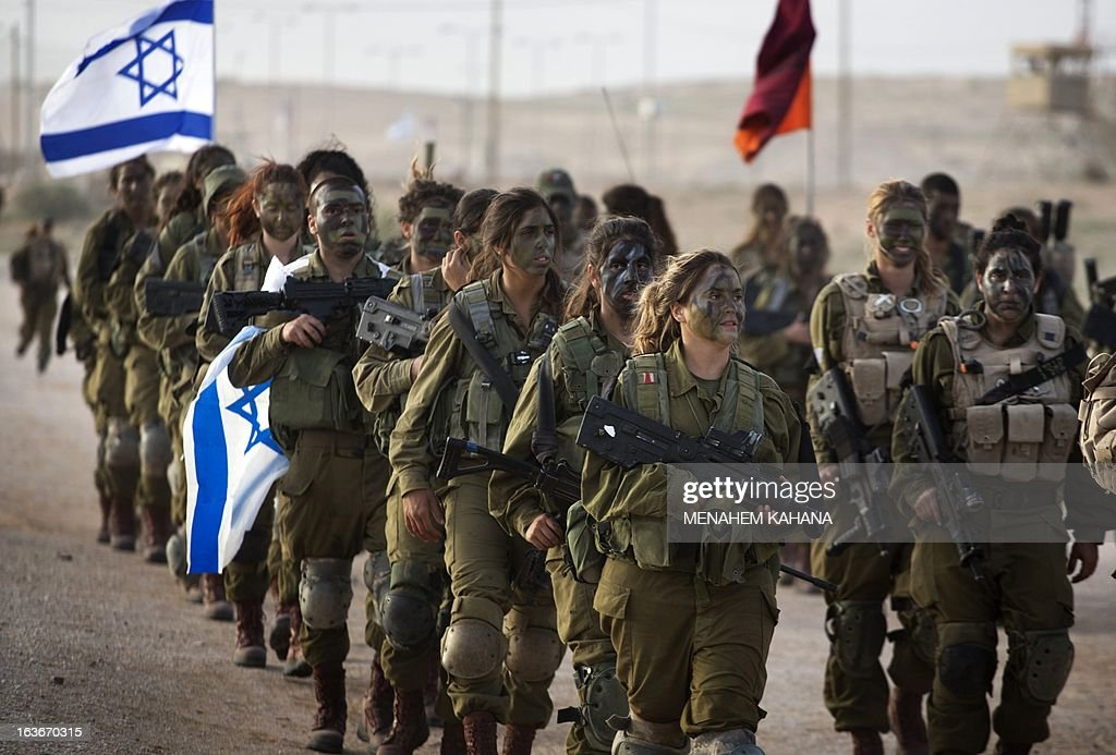 Israeli female soldiers of the 33rd Caracal Battalion take part in a graduation march in the northern part of the southern Israeli Negev desert, on March 13, 2013. The Caracal unit is an infantry combat battalion of the army, composed of both male and female soldiers mostly serving along the Israeli southern desert borders.