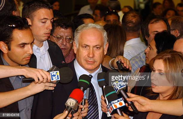 Israeli Finance Minister Benjamin Netanyahu speaks to the press threatened on Tuesday evening to quit unless Prime Minister Ariel Sharon agreed to...