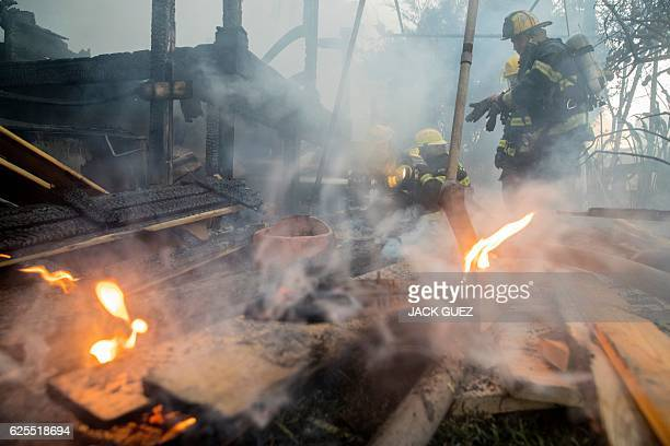 Israeli firefighters help extinguish a fire in the northern Israeli port city of Haifa on November 24 2016 Hundreds of Israelis fled their homes on...