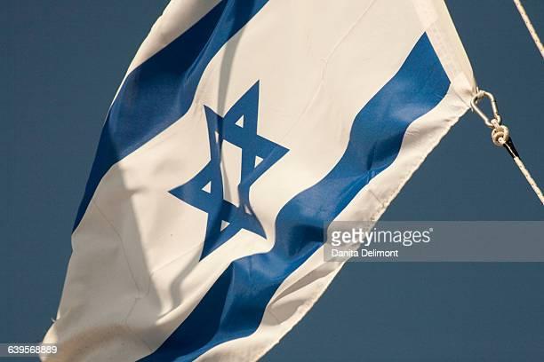 Israeli flag against blue sky, Israel