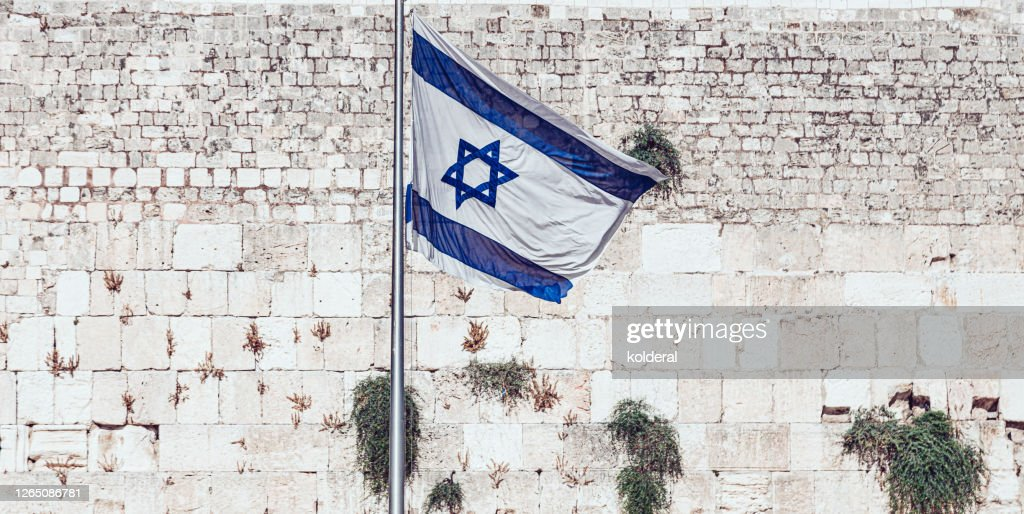 Israeli flag against Western Wall in Old City of Jerusalem : Stock Photo