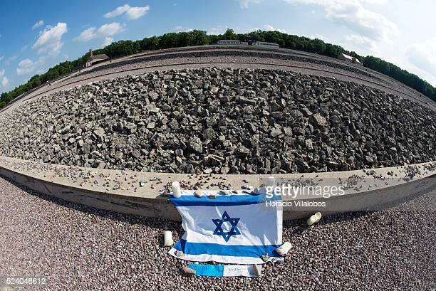 Israeli flag and candles at the memorial created, where Block 22 barracks once stood, with stones brought from the camp's quarry to pay homage to the...