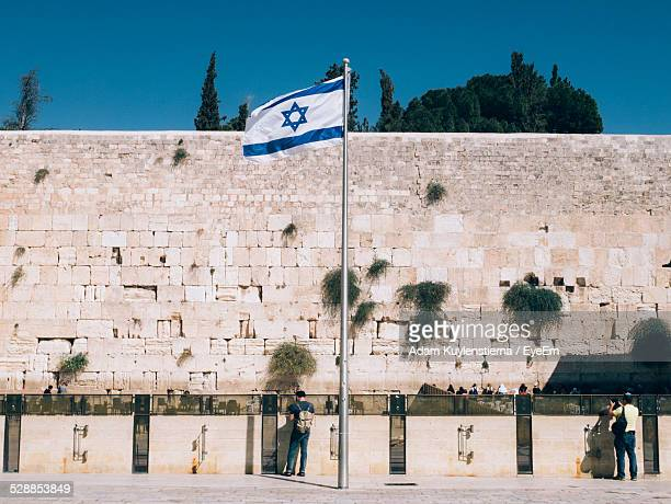 israeli flag waving against western wall - israel flag stock pictures, royalty-free photos & images