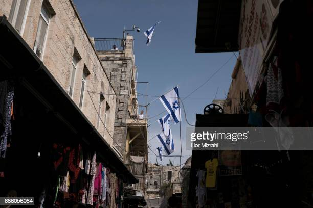 Israeli flags are seen on a house in the Muslim Quarter inside the Old City on May 18 2017 in Jerusalem Israel Israel will celebrate Jerusalem Day on...