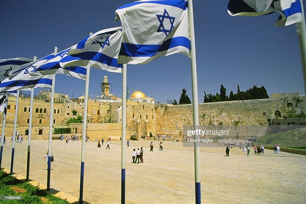 Israeli flags at a shrine and a dome in the background, Wailing Wall, Dome Of The Rock, Jerusalem, Israel : Stock Photo