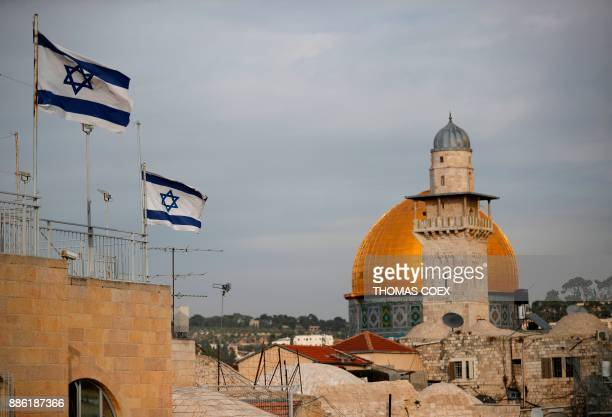 TOPSHOT Israeli flags fly near the Dome of the Rock in the AlAqsa mosque compound on December 5 2017 The EU's diplomatic chief Federica Mogherini...
