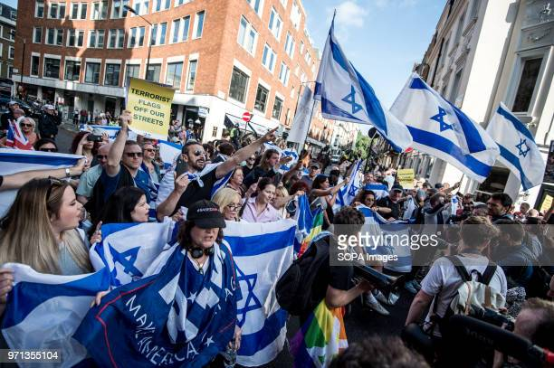 Israeli flags seen at the prozionist counterdemo Hundreds of antiIsrael protesters marched through the streets on the annual Al Quds Day Started by...