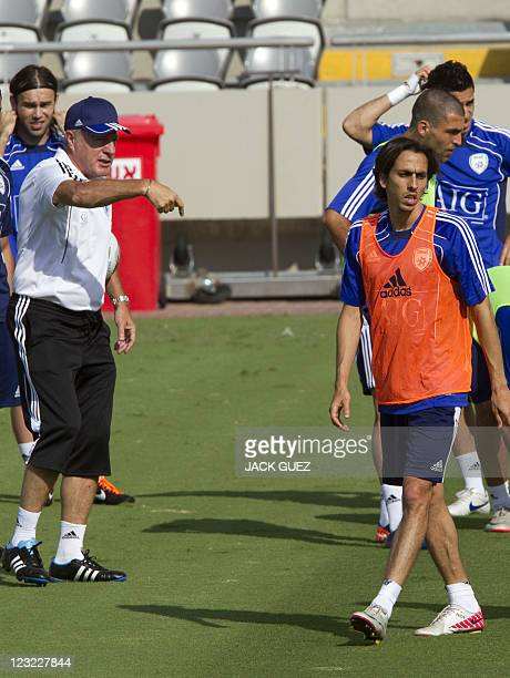 Israeli football team's coach Luis Fernandez of France and midfielder Yossi Benayoun attend a training session at the Bloomfield Stadium in Tel Aviv...