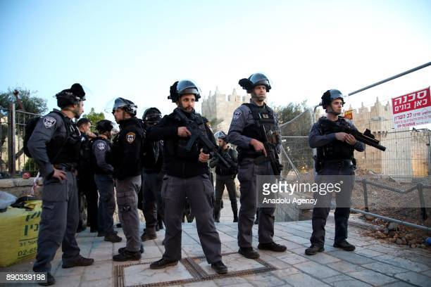 Israeli forces are seen as Palestinians stage a protest against US President Donald Trumps announcement to recognize Jerusalem as the capital of...
