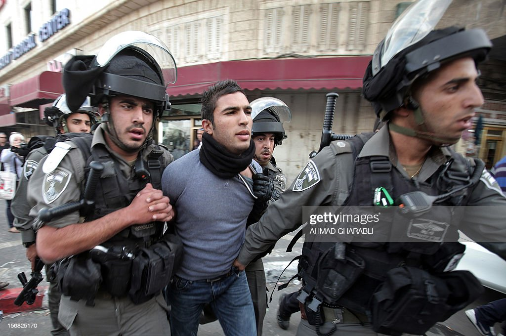 Israeli forces arrest a Palestinian youth on November 22, 2012 after Palestinians threw stones at a police station in Salahaddin street, a main commercial area of mostly Arab east Jerusalem. The incident followed the detainment of a Palestinian woman who tried to stab an Israeli border policeman.