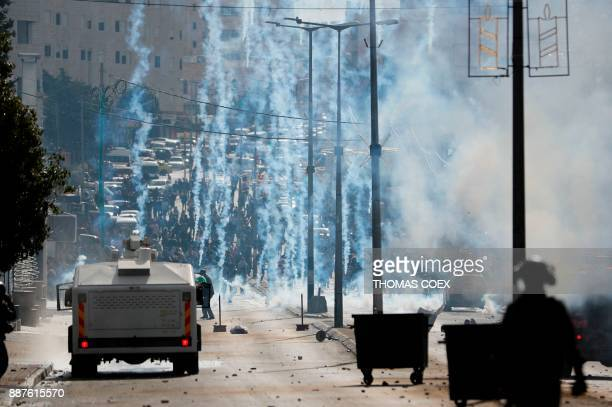TOPSHOT Israeli forces clash with Palestinian protestors near an Israeli checkpoint in the West Bank city of Bethlehem on December 7 2017 US...