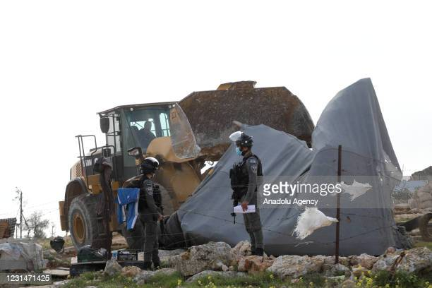 Israeli forces demolish allegedly unauthorized houses belonging to three different Palestinian families in Hebron, West Bank on March 2, 2021....